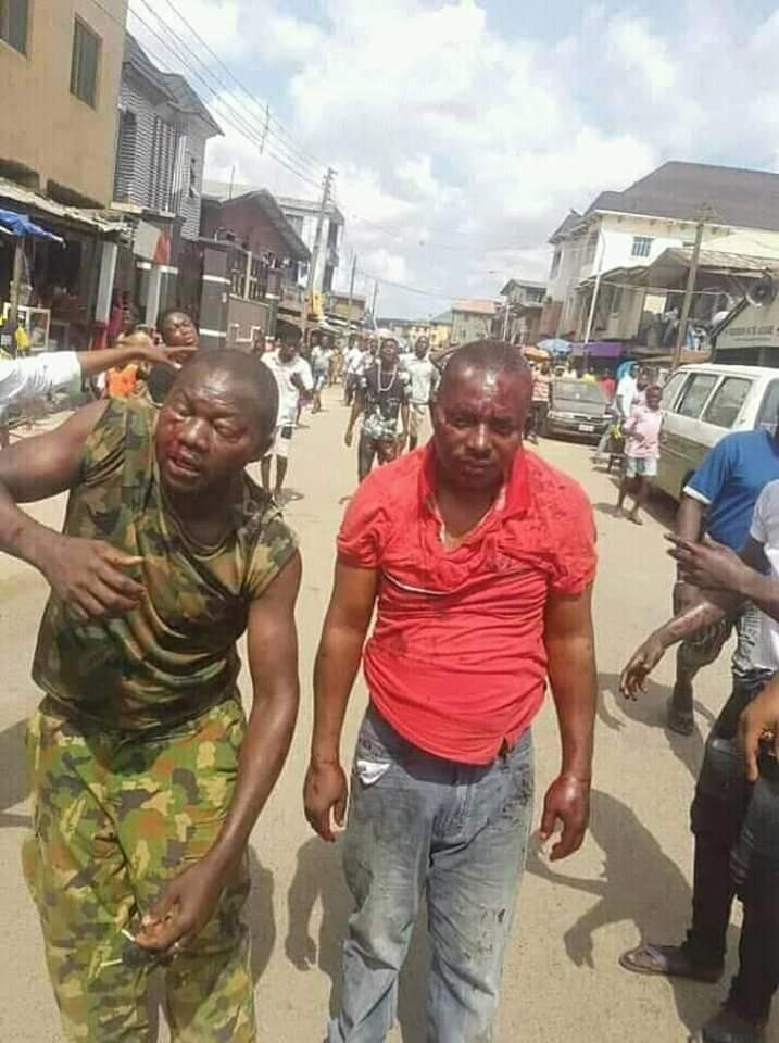 Soldiers Beaten To Pulp In Lagos Over Death Of 'Black Jesus' [Photos] 1