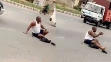 Driver Sits In Middle Of The Road In Protest After Police Seized His Car & Demanded N150k Bribe 4