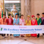 PHOTOS: Japanese In Nigerian Attire Welcome President Buhari As He Lands In Japan 27