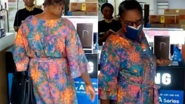 Woman Goes Viral After She Was Caught On Camera Using Bible As Facemask While Shopping [Video] 2
