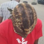 RevolutionNow: Security Operatives Shave Off Protester's Hair With Knife, Broken Bottle In Abuja 30