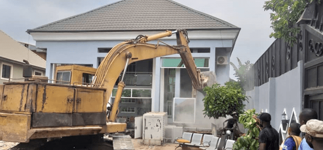 Enugu Government Demolishes House Of Man Who Pulled Down Airport Fence [Photos] 2