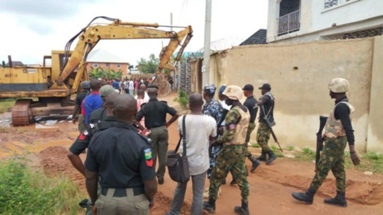 Enugu Government Demolishes House Of Man Who Pulled Down Airport Fence [Photos] 4