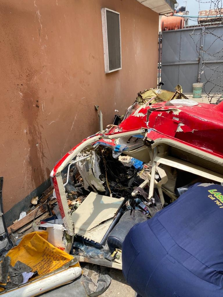 UPDATE: Photos from the scene of helicopter crash in Opebi Lagos 18