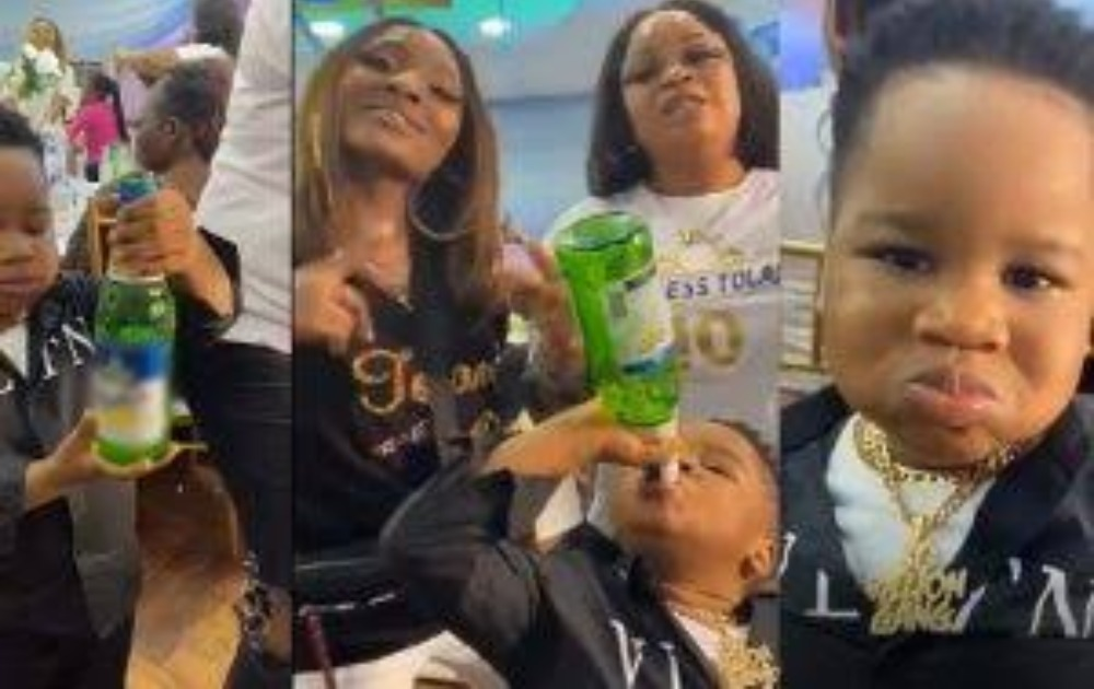 Little Boy Seen Consuming A Bottle Of Beer In The Presence Of Adults During A Party [Video] 1
