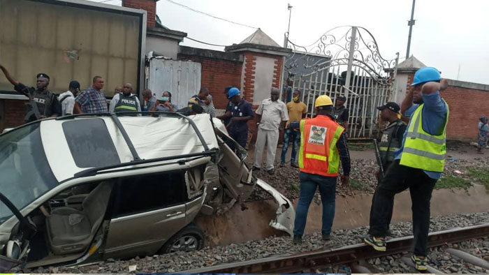 One Passenger Confirmed Dead As Bus, SUV Collides With Moving Train In Oshodi, Lagos [Photos] 1