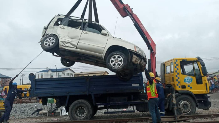 One Passenger Confirmed Dead As Bus, SUV Collides With Moving Train In Oshodi, Lagos [Photos] 3