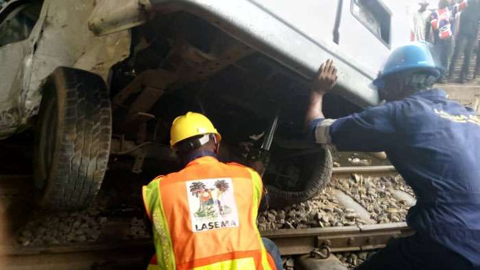 One Passenger Confirmed Dead As Bus, SUV Collides With Moving Train In Oshodi, Lagos [Photos] 4
