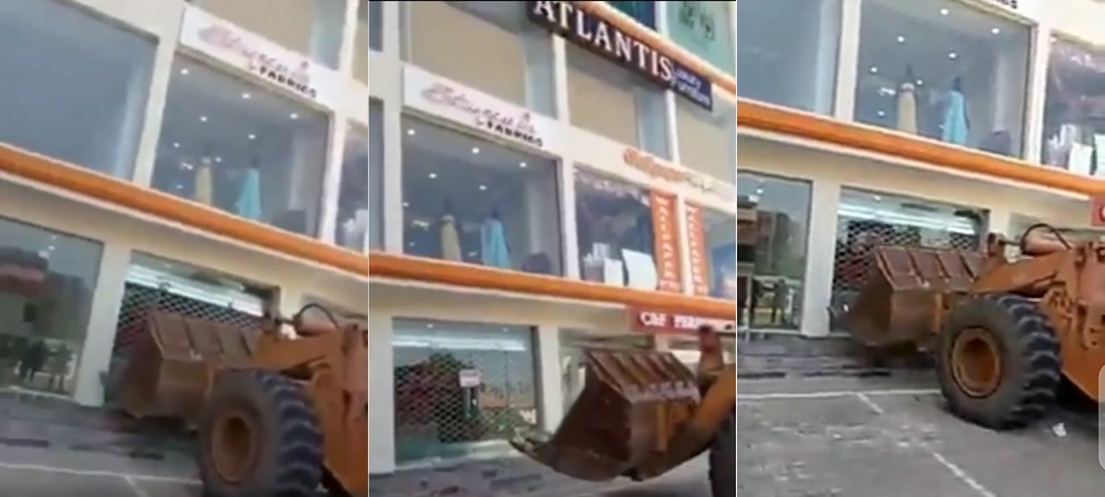 Woman Cries Out As AMAC Officials Demolishes Building With Properties And People Inside [Video] 1