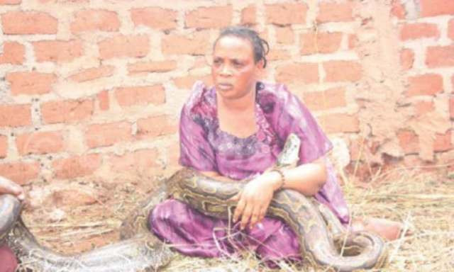 Woman Caught Breastfeeding A Giant Snake While Calling The Names Of Her Enemies 1