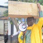 Nigerian Archbishop Protest Against President Buhari With Heavy Coffin On His Head [Photos] 28
