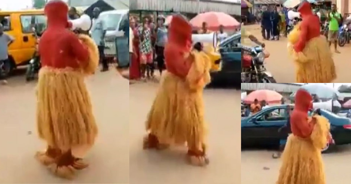 Nigerian Masquerade Spotted Preaching The Word Of God On The Streets [Video]