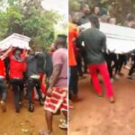 Drama As Corpse Carried By Over 20 Able-Bodied Men Refuses To Be Buried [Video]