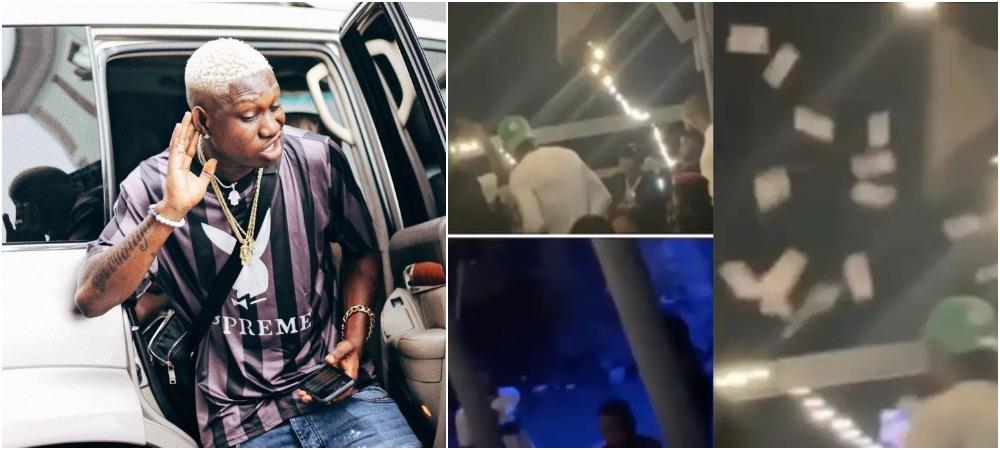 Zlatan Ibile Leaves Fans Scrambling Inside Dirty Water To Get Money He Sprayed [Video]