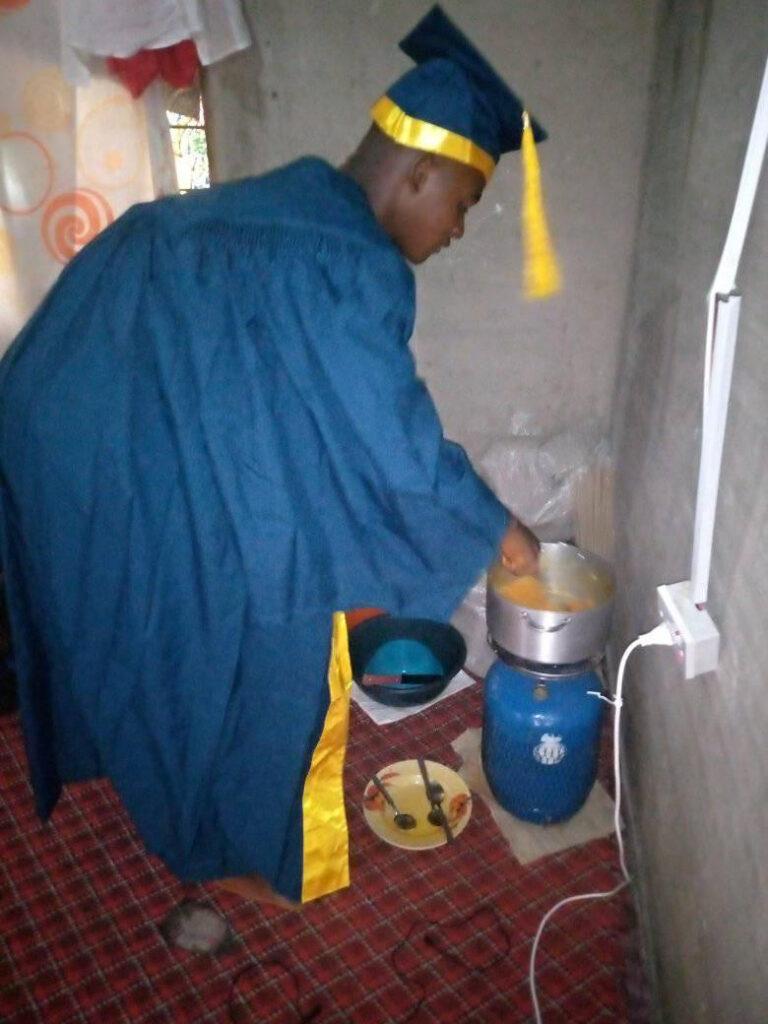 Taraba University Student Seen Cooking, Sleeping In His Matriculation Gown [Photos]
