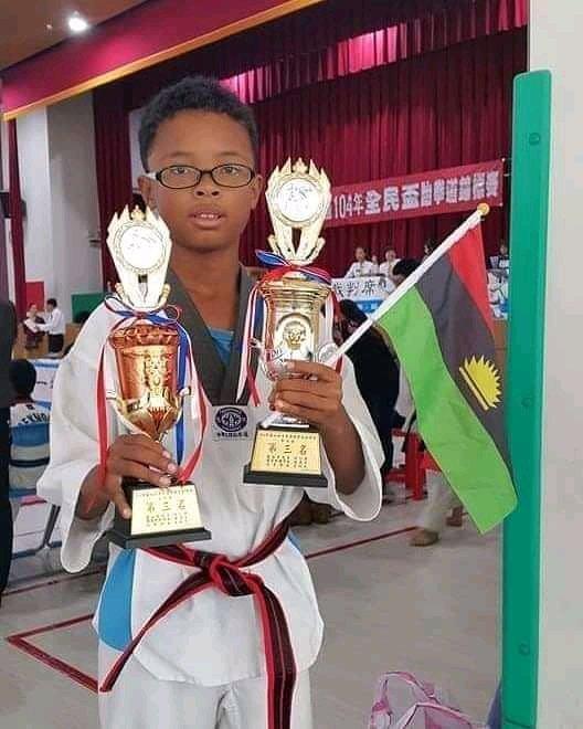 Nigerian Boy Celebrates With Biafran Flag As He Emerges Taekwondo Champion In China