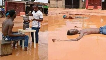 Imo Youths Cook And Swim In Muddy Water To Expose Terrible State Of A Road [Photos]