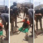Elderly Woman Challenges Security Operatives Trying To Arrest For Wearing Biafra Outfit [Video]