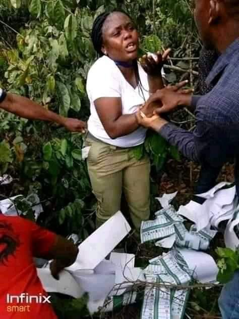 Youth Corper caught inside the bush thumb printing ballot papers for APC - PHOTOS 1