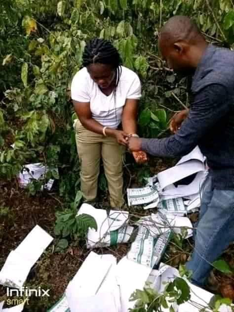 Youth Corper caught inside the bush thumb printing ballot papers for APC - PHOTOS 2