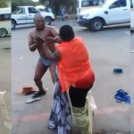 Woman Strips Off Her Husband's Cloths As They Publicly Fights Dirty On The Streets [Photos] 30