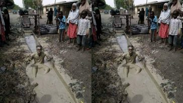 Another Man Dips Himself Inside Dirty Gutter To Celebrate President Buhari's Victory [Photo] 4