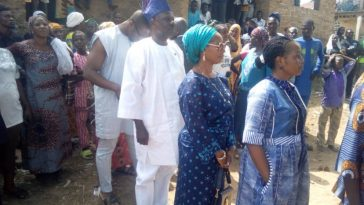 PHOTONEWS: Governor Ibikunle Amosun And Wife Wait In Line To Cast Their Votes 1