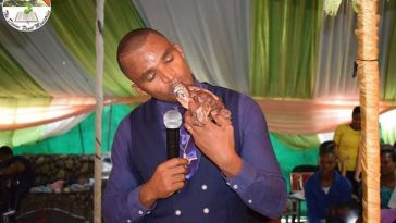 Pastor Kills A Dog, Eats It Raw In Church And Feeds It To Members [Photos] 2