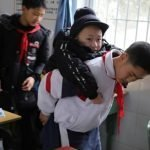 Meet The 12-Year-Old Boy Who Carries His Disabled Friend To School For The Past 6 Years [Photos] 28